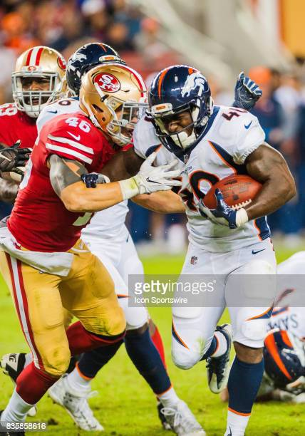Denver Broncos running back Juwan Thompson tries to stiff arm San Francisco 49ers tight end Cole Hikutini as he races towards the end zone for a...