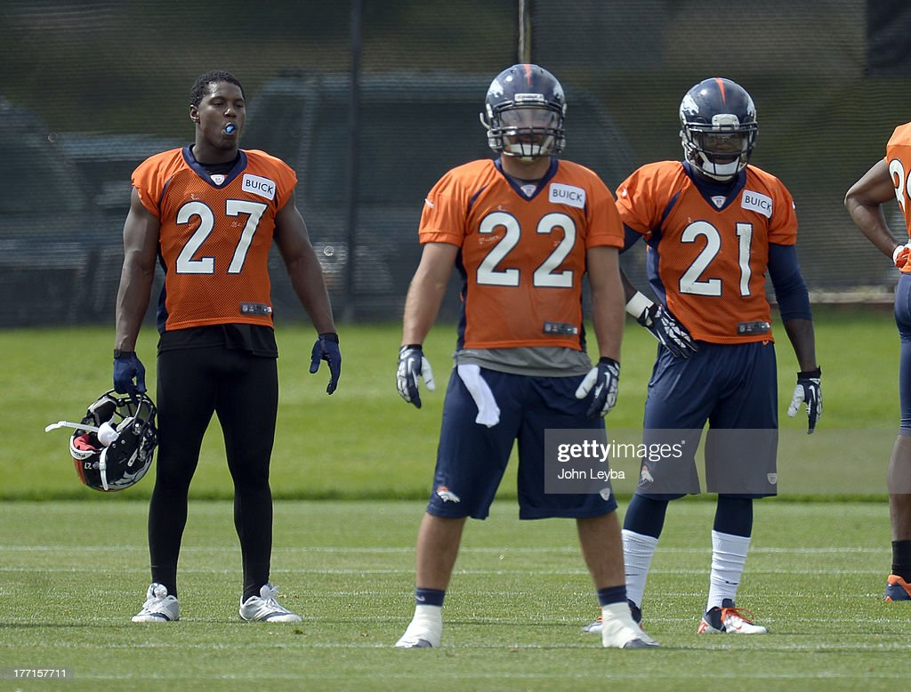 Denver Broncos running back Knowshon Moreno (27) and Denver Broncos running back Ronnie Hillman (21) look on as Denver Broncos running back Jacob Hester (22) prepares to run a play during practice August 22, 2013 at Dove Valley