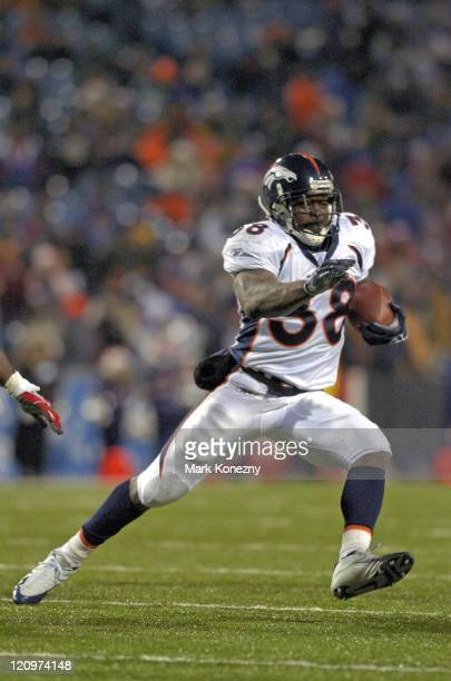Denver Broncos running back Mike Anderson runs for yardage during a game against the Buffalo Bills at Ralph Wilson Stadium in Orchard Park, New York...