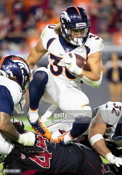 Denver Broncos running back Phillip Lindsay runs through traffic during NFL football game between the Arizona Cardinals and the Denver Broncos on...