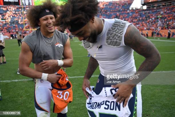 Denver Broncos running back Phillip Lindsay trades jerseys with Seattle Seahawks defensive back Tedric Thompson after the game on Sunday September 9...