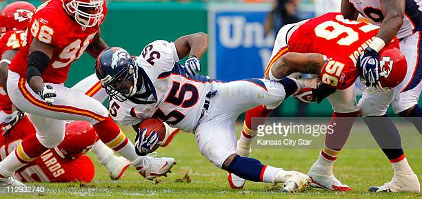 Denver Broncos running back Selvin Young picks up two yards before being stopped by Kansas City Chiefs linebacker Derrick Johnson in the second...