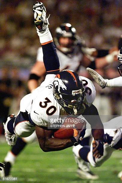 Denver Broncos running back Terrell Davis dives for yardage in first half action against the Atlanta Falcons during Super Bowl XXXIII 31January at...