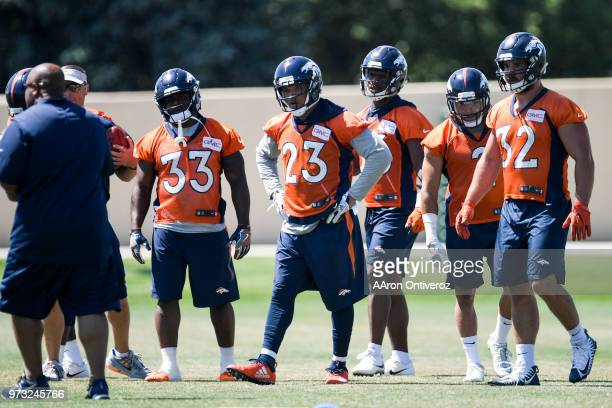 Denver Broncos running backs from left to right De'Angelo Henderson Sr Devontae Booker David Williams Phillip Lindsay and Andy Janovich workout...