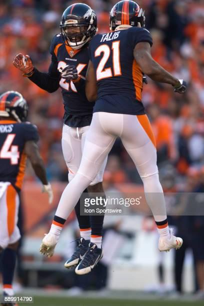 Denver Broncos safety Darian Stewart celebrates with cornerback Aqib Talib during the New York Jets vs Denver Broncos football game at Sports...