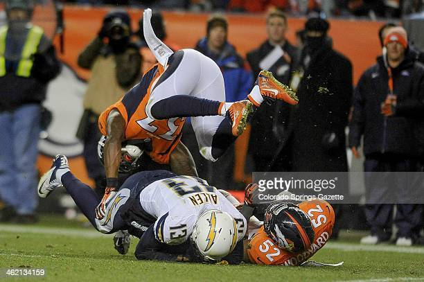 Denver Broncos safety Duke Ihenacho flips over San Diego Chargers wide receiver Keenan Allen while helping Broncos linebacker Wesley Woodyard make...