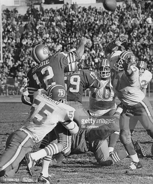 OCT 25 1970 OCT 26 1970 Denver Broncos San Francisco 49er quarterback John Brodie is his by Denver defensive end Pete Duranko just after firing pass...
