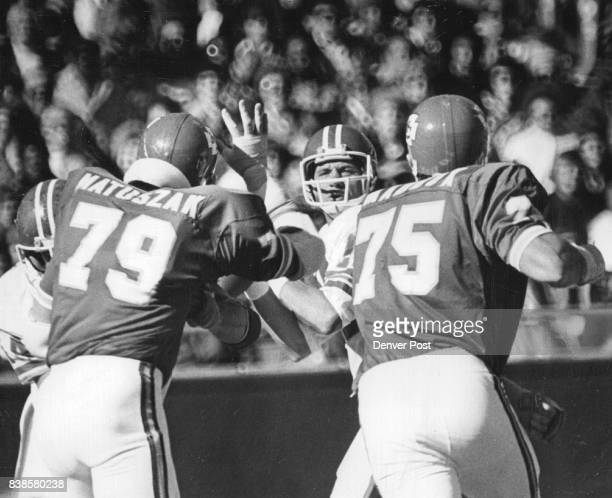 Denver Broncos 'Seems to me I've seen these guys before' Denver quarterback Charley Johnson is bracketed by pair of KC linemen John Matuszak and Bob...
