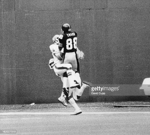 OCT 12 1975 OCT 13 1975 Denver Broncos Steelers' Lynn Swann's great catch nets touchdown Broncos'' Bill Thompson wrestles for ball after Louis Wright...