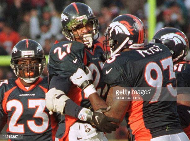 Denver Broncos Steve Atwater and Trevor Pryce celebrate Atwater's interception during the first half of their game against the San Diego Chargers 21...