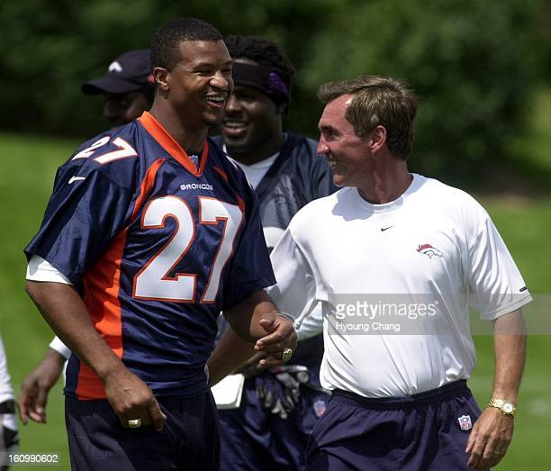 Denver Broncos Steve Atwater left leaves the practice field with headcoach Mike Shanahan after the last practice at Broncos Head Quater on Friday