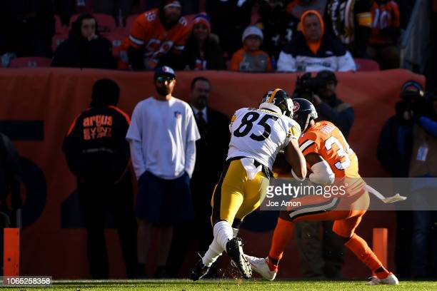 Denver Broncos strong safety Will Parks knocks the ball loose from Pittsburgh Steelers tight end Xavier Grimble to save a touchdown during the second...