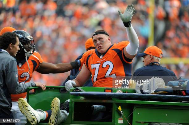 Denver Broncos tackle Garett Bolles acknowledges the fans while leaving the field after suffering a leg injury in the third quarter against the...