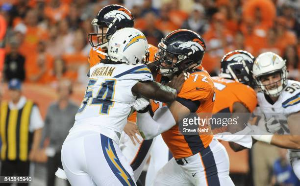Denver Broncos tackle Garett Bolles blocks Melvin Ingram of the Los Angeles Chargers in the first quarter at Sports Authority Field at Mile High on...