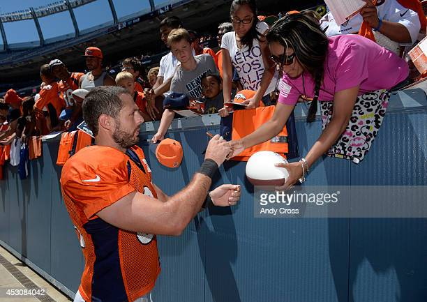 Denver Broncos TE, Jacob Tamme, signs autographs for the fans after practice and scrimmage at Sports Authority Field at Mile High Saturday afternoon,...