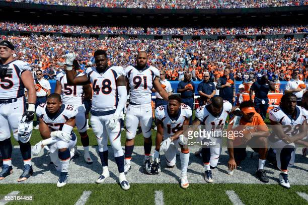 Denver Broncos team take a knee during the national anthem during their game against the Buffalo Bills on September 24 2017 at New Era Field in...