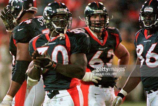 Denver Broncos' Terrell Davis looks to the jumbotron and applauds after running for 1,000 yards in six games 25 October against the Jacksonville...