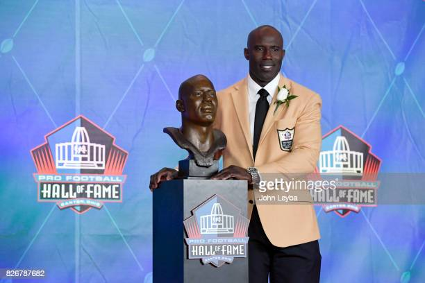 Denver Broncos Terrell Davis poses for photos with his bust after his speech at the Pro Football Hall of Fame Enshrinement ceremony on August 5 2017...