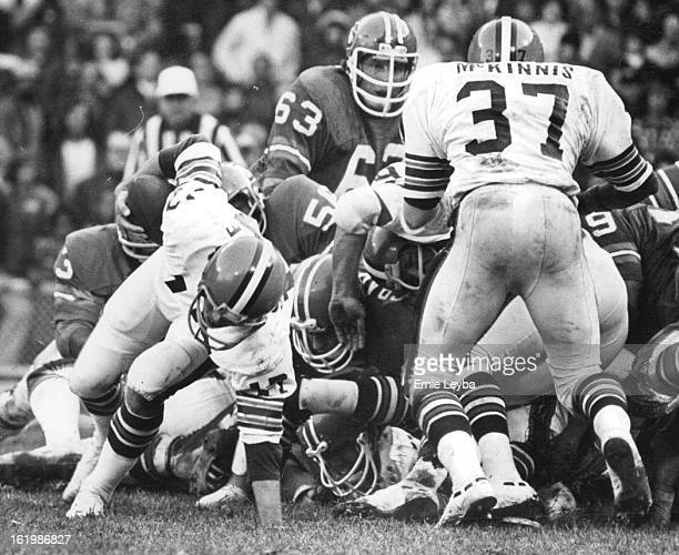 OCT 27 1974 OCT 28 1974 Denver Broncos There was no hole up the middle for Browns Quarterback Brian Sipe nearly falls to ground after bouncing off...