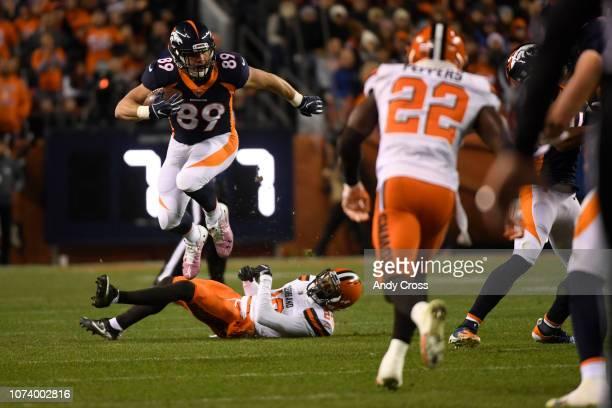 Denver Broncos tight end Brian Parker jumps over Cleveland Browns cornerback Briean BoddyCalhoun in the first quarter as the Denver Broncos played...