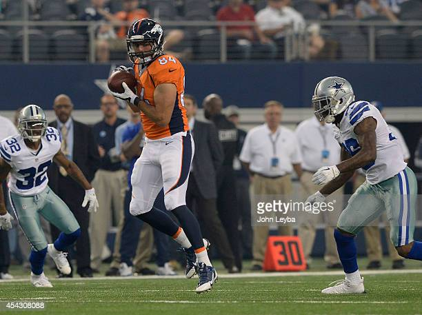Denver Broncos tight end Jacob Tamme catches a pass during the first quarter in front of Dallas Cowboys safety Ahmad Dixon August 28, 2014 at AT&T...