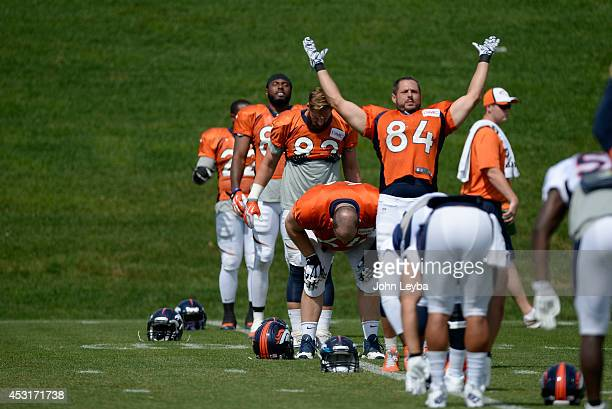 Denver Broncos tight end Jacob Tamme stretches during day 11 of the Denver Broncos 2014 training camp August 4, 2014 at Dove Valley.