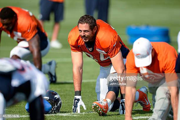 Denver Broncos tight end Jacob Tamme stretches on day five of the Denver Broncos 2014 training camp July 28, 2014 at Dove Valley.