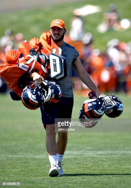 Denver Broncos tight end Jake Butt walks off the field carrying the tight ends equipment after practice during training training camp on July 31 2017...