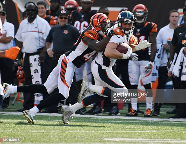 Denver Broncos tight end Jeff Heuerman catches a pass on Cincinnati Bengals free safety George Iloka during the fourth quarter September 25 2016 at...