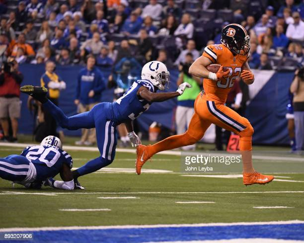 Denver Broncos tight end Jeff Heuerman rumbles pas Indianapolis Colts cornerback D.J. White for a touchdown during the third quarter on December 14,...