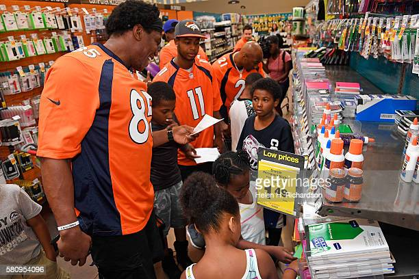 Denver Broncos tight end Virgil Green #85 and wide receiver Jordan Norwood #11 shop with Samari Jelks in the middle and Darrell HugleyJones 9 on...