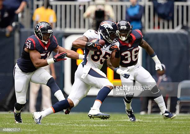 Denver Broncos tight end Virgil Green picks up a big gain as Houston Texans inside linebacker Darryl Sharpton and Houston Texans strong safety DJ...