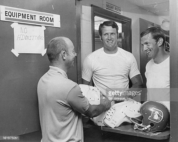 JUL 11 1969 JUL 13 1969 Denver Broncos Training Camp L to R Larry Elliott egiup mgr Lou Andrus Linebacker ***** QB Par Of Broncos Pick Up Equipment...
