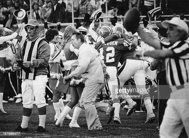 SEP 21 1975 SEP 22 1975 Denver Broncos Whole lot of celebrating going on Coach John Ralston leads the cheering on the west sidelines after the...
