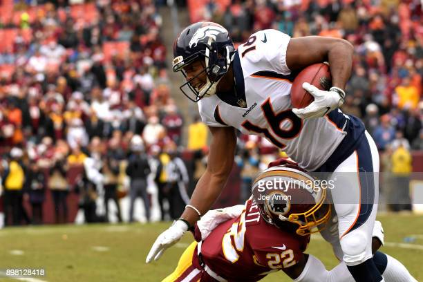 Denver Broncos wide receiver Bennie Fowler drives through a tackle by Washington Redskins strong safety Deshazor Everett in the first half as they...
