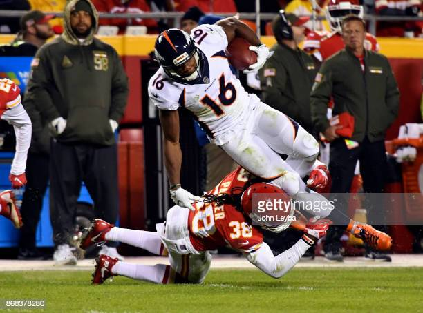 Denver Broncos wide receiver Bennie Fowler gets upended by Kansas City Chiefs free safety Ron Parker after a gain during the third querier on October...