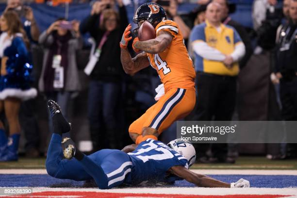 Denver Broncos wide receiver Cody Latimer catches a 22 yard touchdown pass over Indianapolis Colts cornerback D.J. White during the NFL game between...