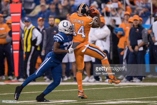 Denver Broncos wide receiver Cody Latimer catches a a pass over Indianapolis Colts cornerback D.J. White during the NFL game between the Denver...