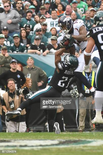 Denver Broncos wide receiver Cody Latimer catches a pass over Philadelphia Eagles cornerback Patrick Robinson during a NFL football game between the...