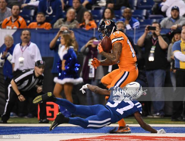 Denver Broncos wide receiver Cody Latimer catches a touchdown pass on Indianapolis Colts cornerback D.J. White during the third quarter on December...