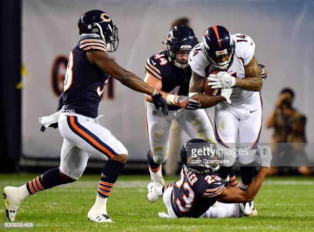Denver Broncos wide receiver Cody Latimer is tackled by Chicago Bears cornerback Kyle Fuller during the preseason game between the Denver Broncos and...