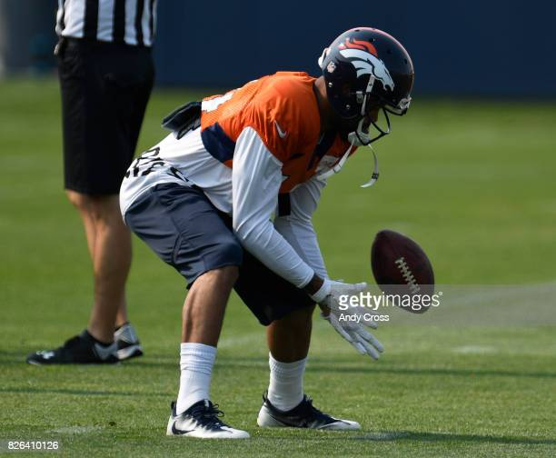 Denver Broncos wide receiver Cody Latimer scoops up the ball during drills at Dove Valley August 04 2017