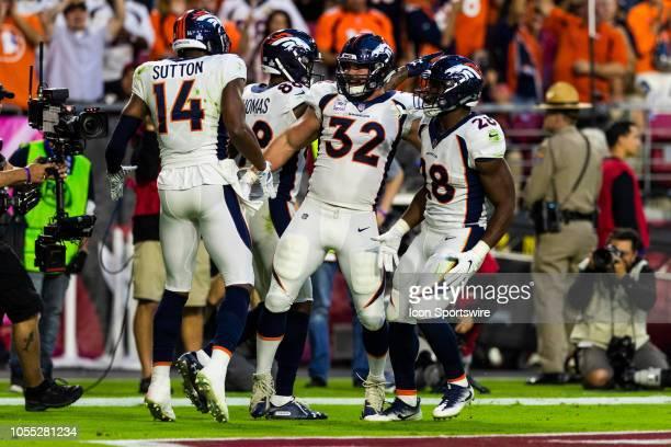 Denver Broncos wide receiver Courtland Sutton celebrates his touchdown catch with Denver Broncos fullback Andy Janovich and Denver Broncos running...