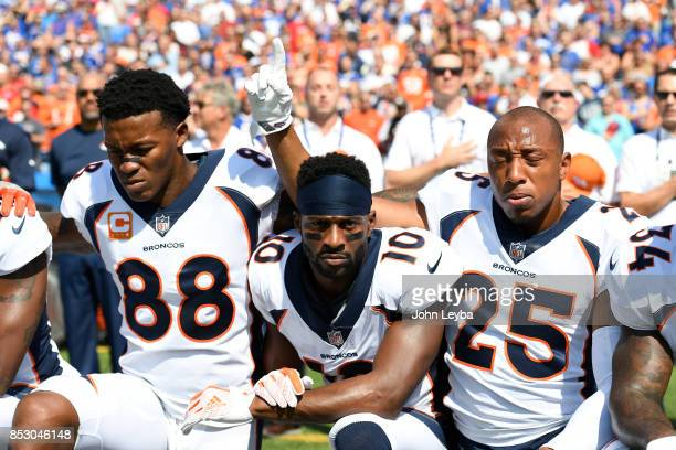 Denver Broncos wide receiver Demaryius Thomas Denver Broncos wide receiver Emmanuel Sanders and Denver Broncos cornerback Chris Harris kneel during...