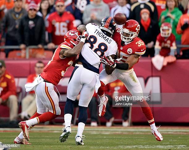 Denver Broncos wide receiver Demaryius Thomas gets hit by Kansas City Chiefs cornerback Marcus Cooper and Kansas City Chiefs defensive back Quintin...
