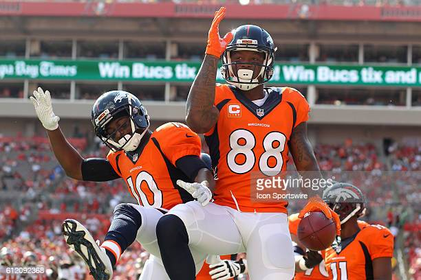 Denver Broncos wide receiver Demaryius Thomas leaps in the air and celebrates with Emmanuel Sanders during the regular season game between the Denver...