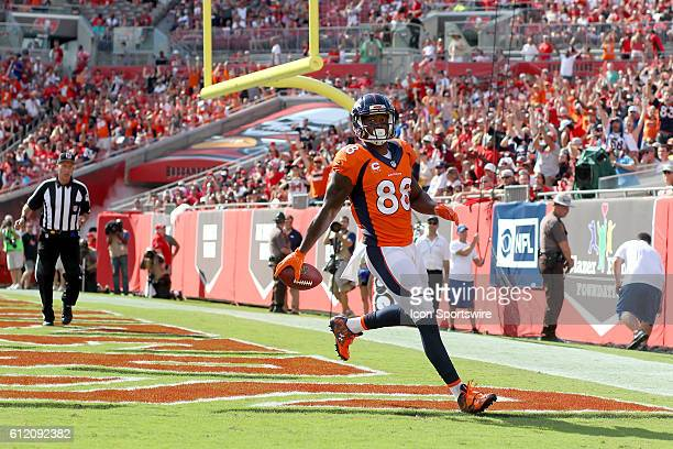 Denver Broncos wide receiver Demaryius Thomas reaches the end zone for a touchdown and then celebrates in the 1st quarter of the NFL regular season...