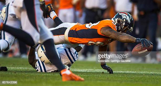 Denver Broncos wide receiver Demaryius Thomas stretches over Indianapolis Colts cornerback Vontae Davis for first down at the Colts 28yard line on...