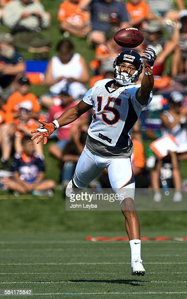 Denver Broncos wide receiver DeVier Posey reaches out for a pass during practice on the first day of training camp at UCHealth Training Facility July...