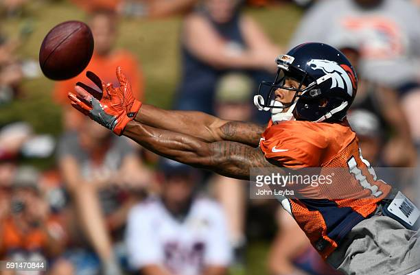 Denver Broncos wide receiver DeVier Posey reaches out for a pass during one on one drills during their joint practice with the San Francisco 49ers...